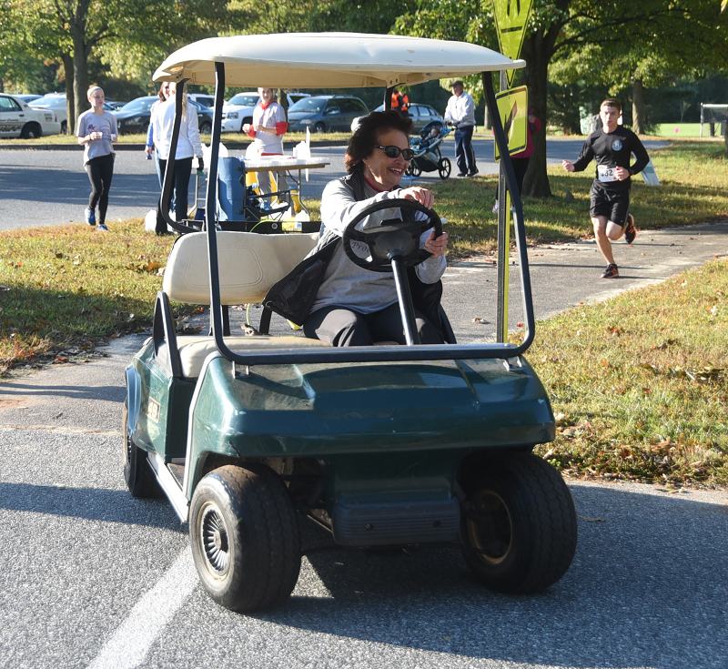 Our Lisa Leading the Way On the Golf Cart
