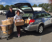 Mothers Matter Committee member JoAnn McPoyle and husband Terry Loading Up The Ronald McDonald House Car