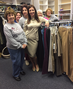 Riccina selecting clothes from the Suited for Work closet