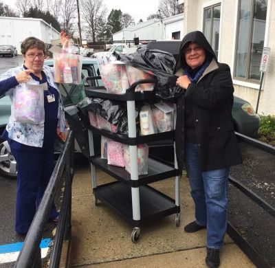 Mothers Matter volunteersTerry Mancini and Kathy Schultes with Comfort Gift Bags