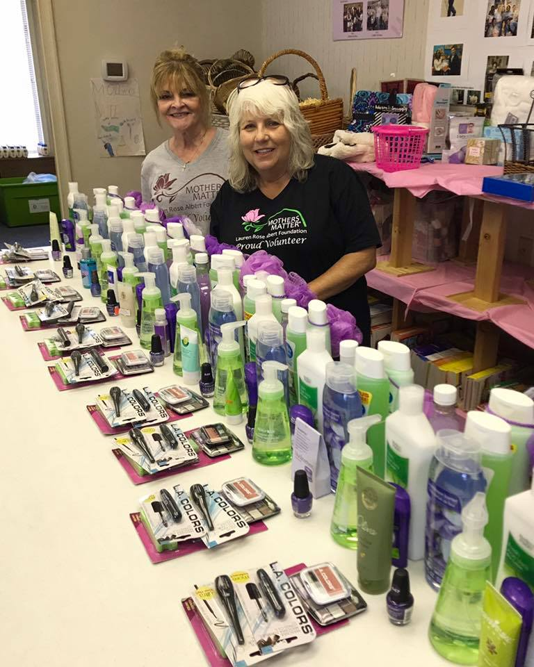 "Linda Ardire-Beach and Sue Kane working on ""Spa"" gift bags"